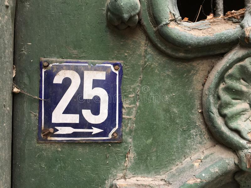 House number 25. On vintage grunge plate stock photography