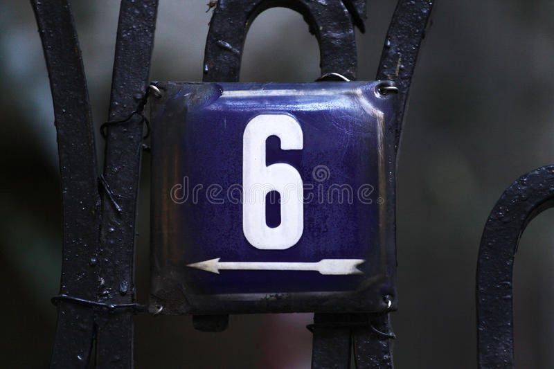 House number on a wall. House numbers in different styles and colors (concept for real estate royalty free stock photography
