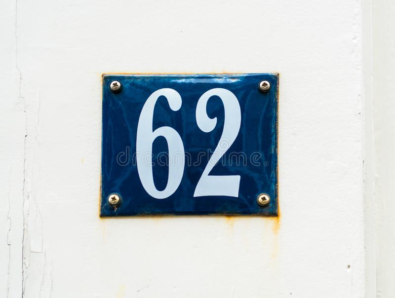 House number 62 white numbers on blue shield stock image