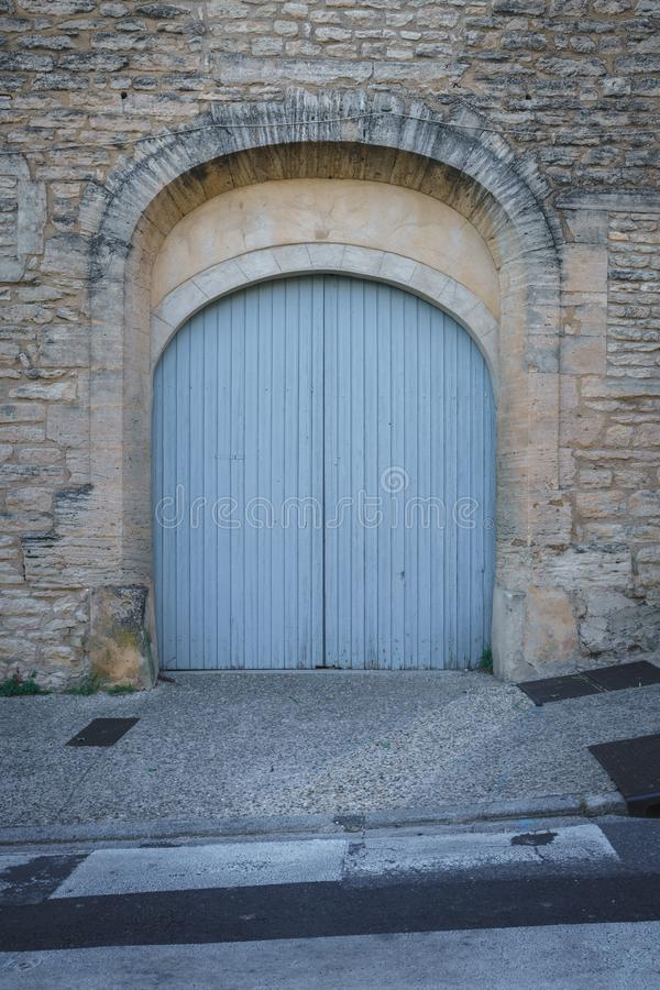 A House With Old Wooden Door, Blue Gate in the Street, Gordes, France royalty free stock images
