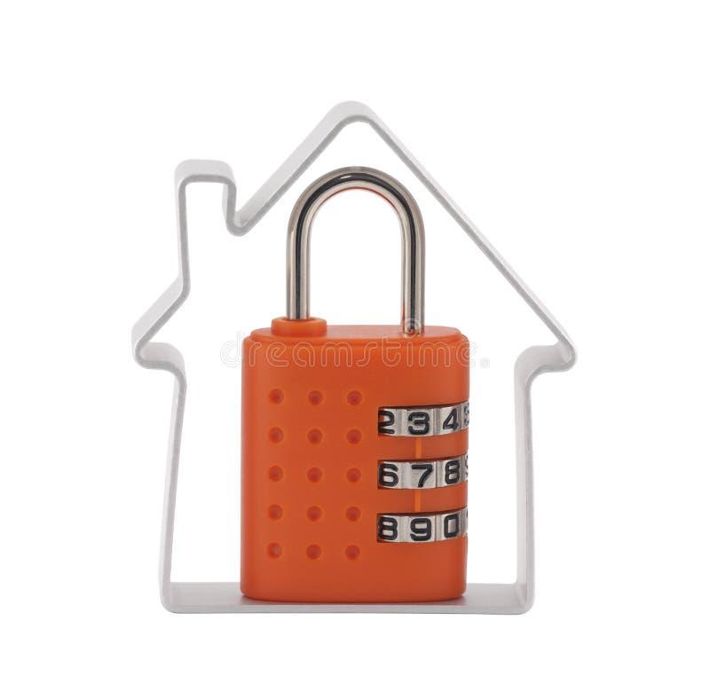 House and orange combination padlock royalty free stock photography