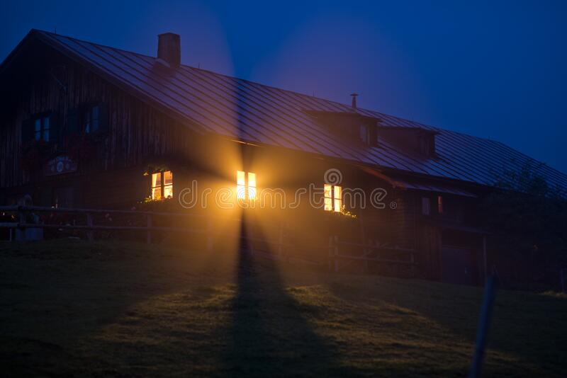 House With Orange Light during Night Time stock photos