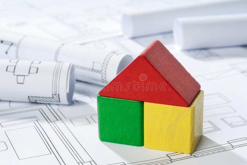House out of blocks on blueprint stock photos