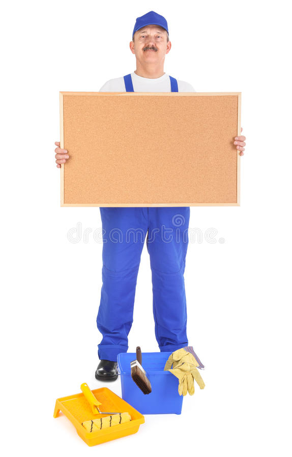 House painter showing empty corkboard royalty free stock images