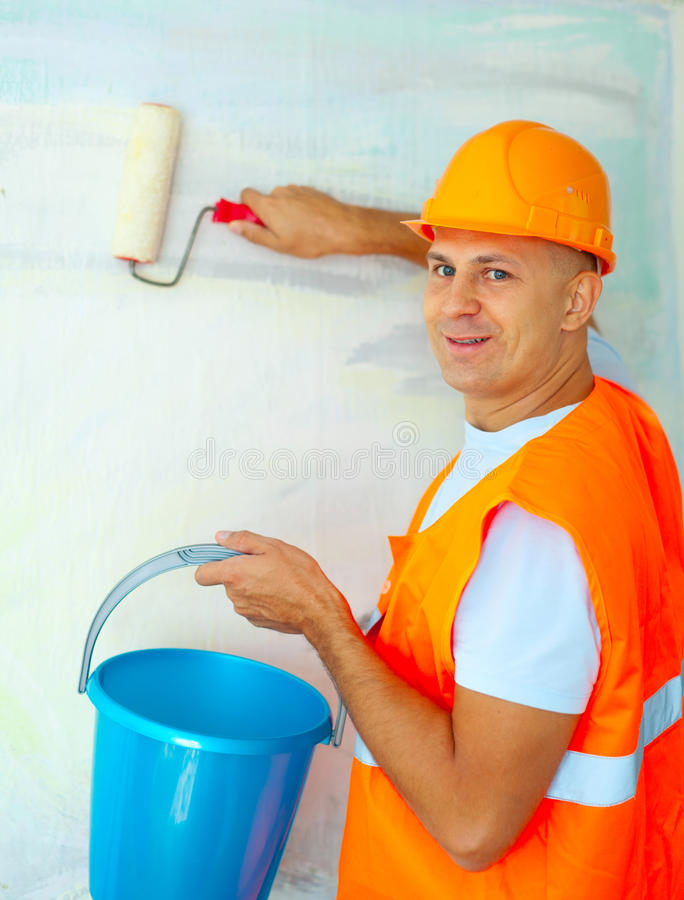 House painters with paint roller. Male house painters with paint roller in new house stock photos