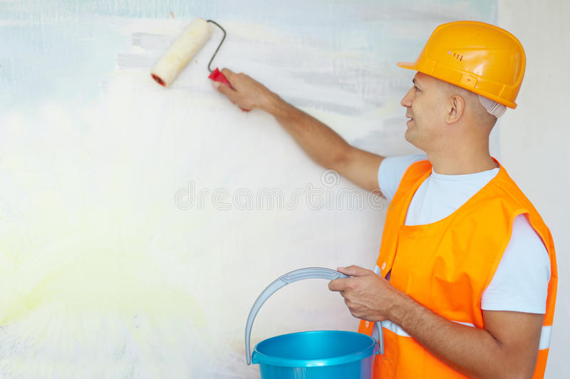House painters with paint roller. Male house painters with paint roller in new house stock images