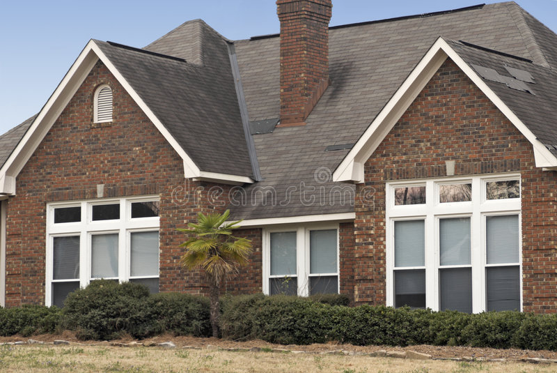 House With Patched Roof Stock Photography