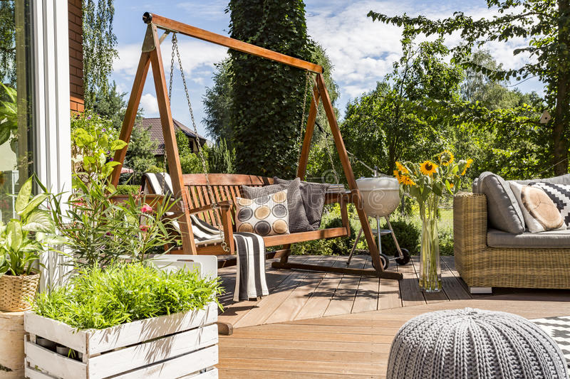 House patio with the garden swing royalty free stock photography