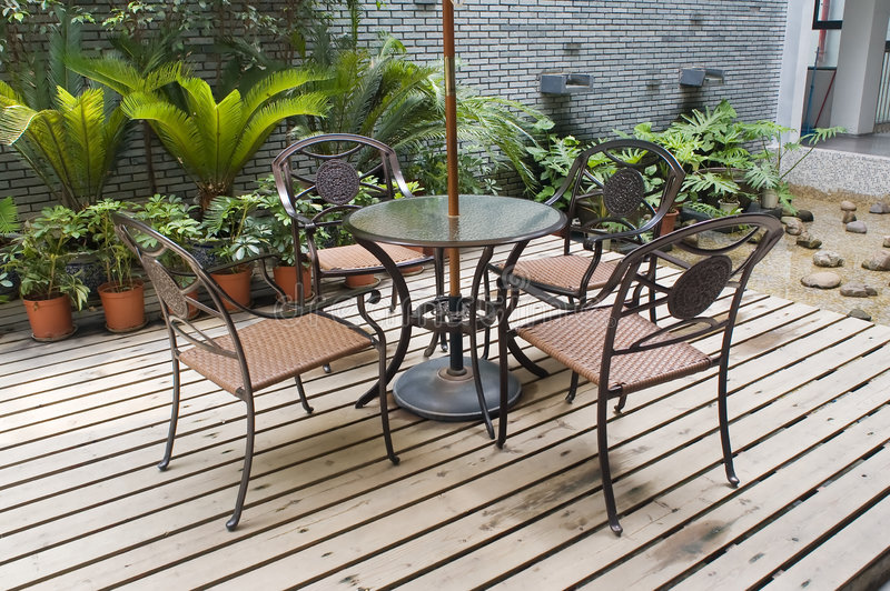 House patio with table and chairs stock photography