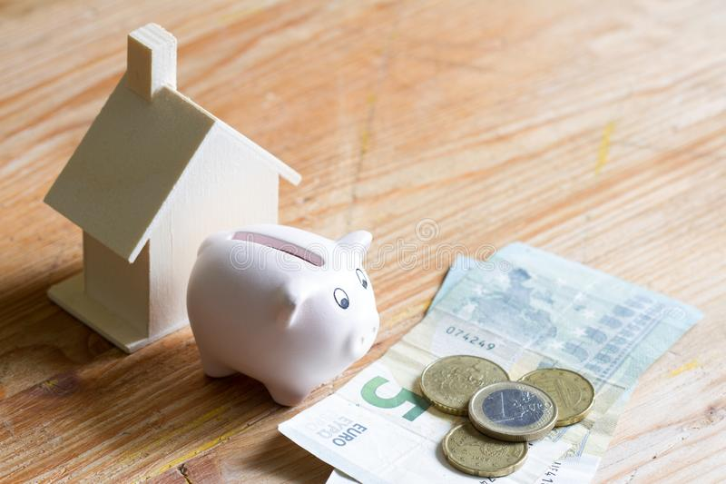 House piggybank and euro money expenses and maintenance concept. Background royalty free stock images