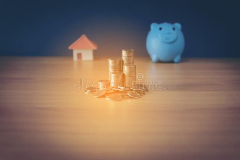 House placed on coins Men`s hand is planning savings money of coins to buy a home concept concept for property ladder, mortgage royalty free stock image