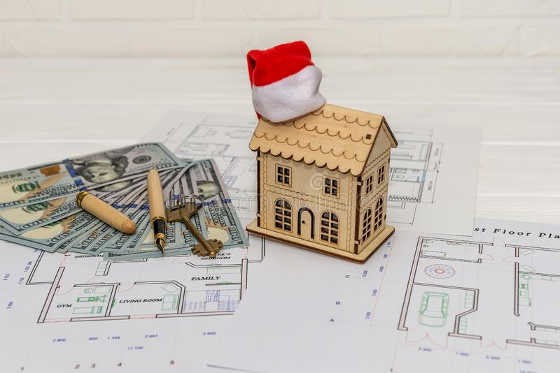 House plan with house model, dollars and key.  royalty free stock photo