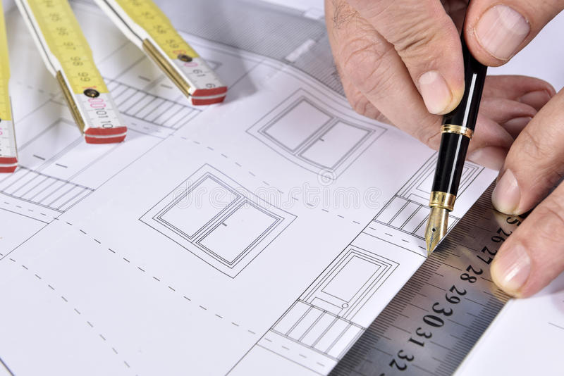 House plan. Pencil and hands royalty free stock images
