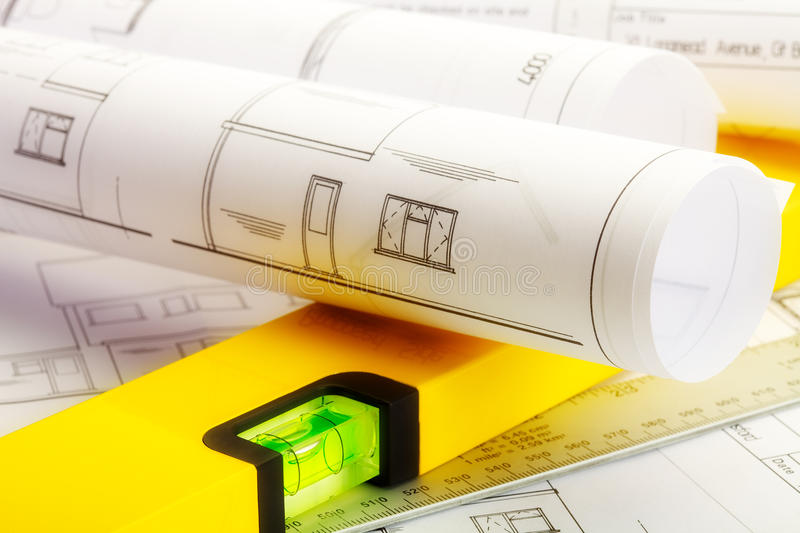 House plans. Close up image of plans for a house with ruler and spirit level royalty free stock photography