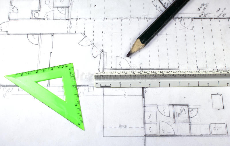 House plans. With triangle, carpenter pencil and ruler stock images