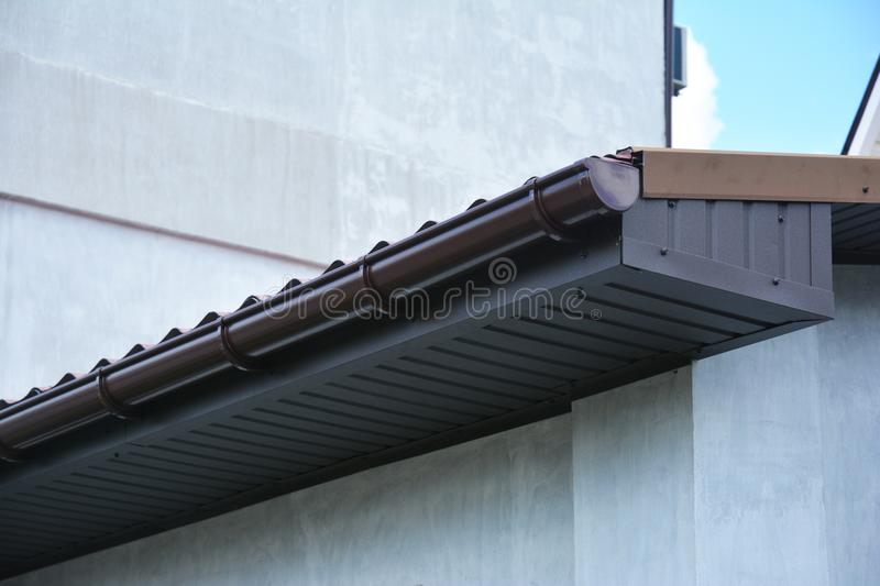 House plastic roof gutter with soffit and fascia board. Close up on house plastic roof gutter with soffit and fascia board stock image