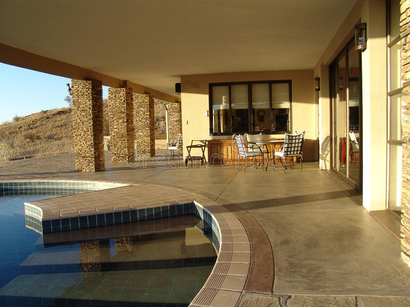 House with pool in African desert royalty free stock image