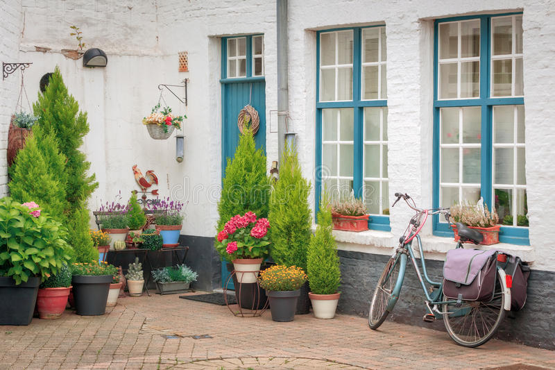 House porch decorated with flowers royalty free stock photos