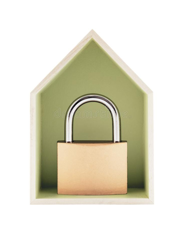 House protection concept. Small wooden house with metal padlock stock images