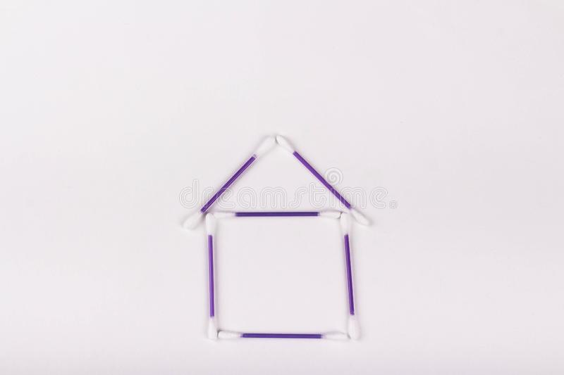 House of purple cotton buds on a white background, copy space. House of purple cotton buds on a white background, hygiene concept, copy space ear plastic swab royalty free stock photography