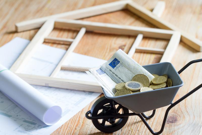 House with puzzles and planning expenses for building a house abstract concept stock image