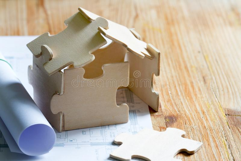 House with puzzles and planning expenses for building a house abstract concept. Background royalty free stock photos
