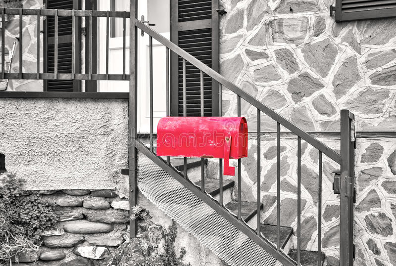 House red mailbox. Black and white photo stock photography