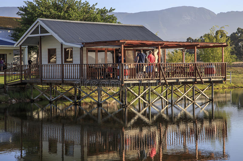 House reflected in scenic lake stock photography