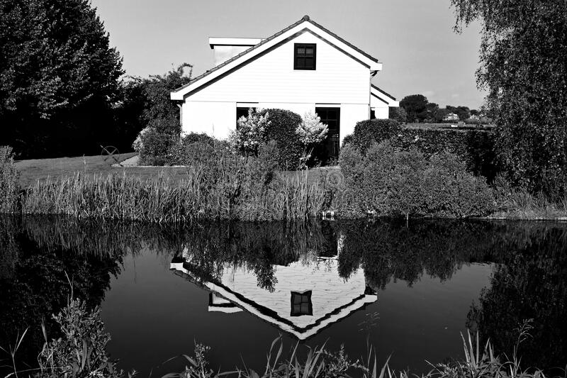 House reflecting in water stock photo