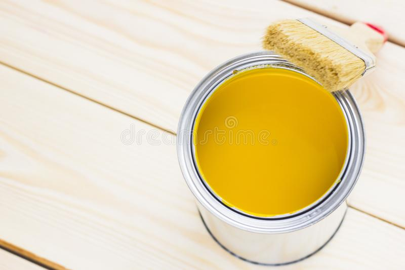 House renovation concept, colorfull paint cans and paintbrushes on wooden background stock image