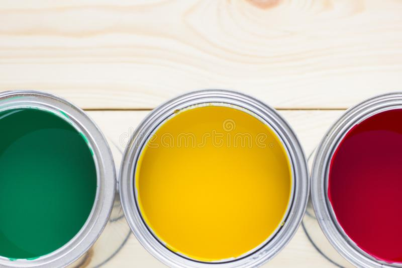 House renovation concept, colorfull paint cans on wooden background stock photo