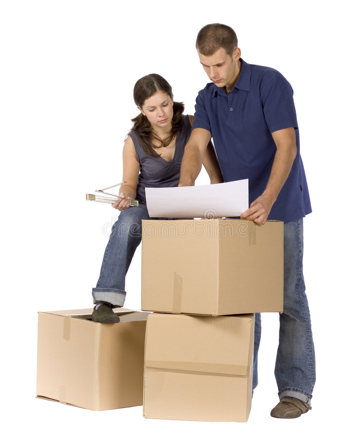 House renovation - couple at the cardboard boxes royalty free stock photography
