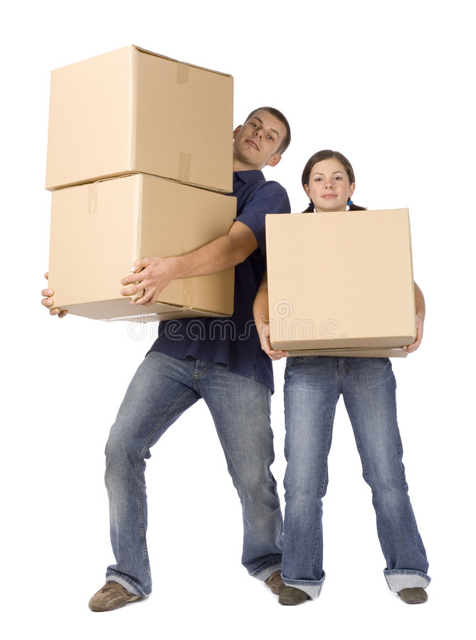 House renovation - couple carrying boxes stock photos