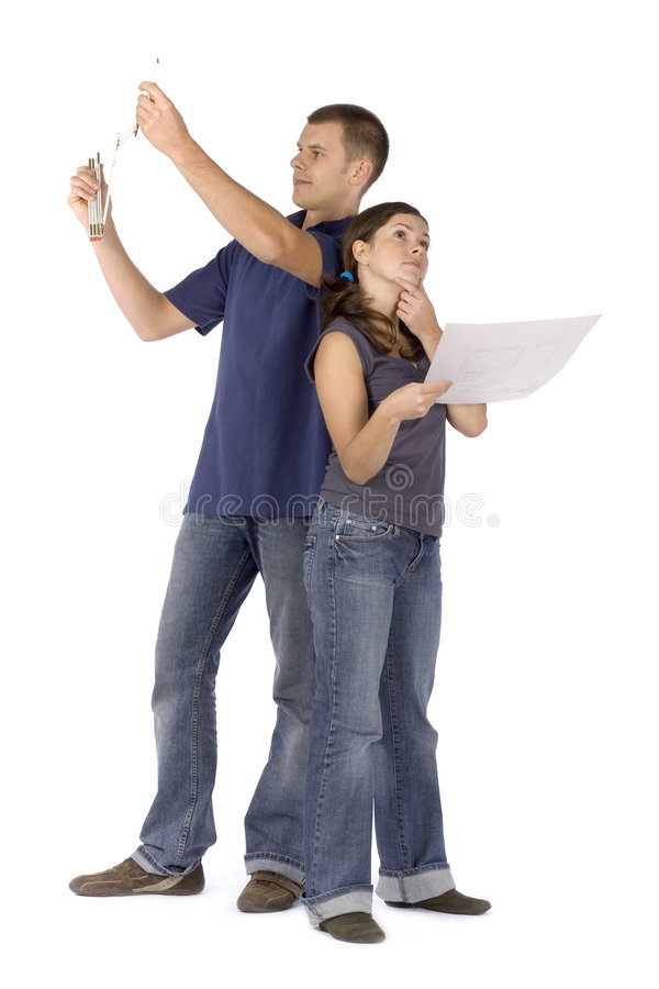 House renovation - couple looking around stock images