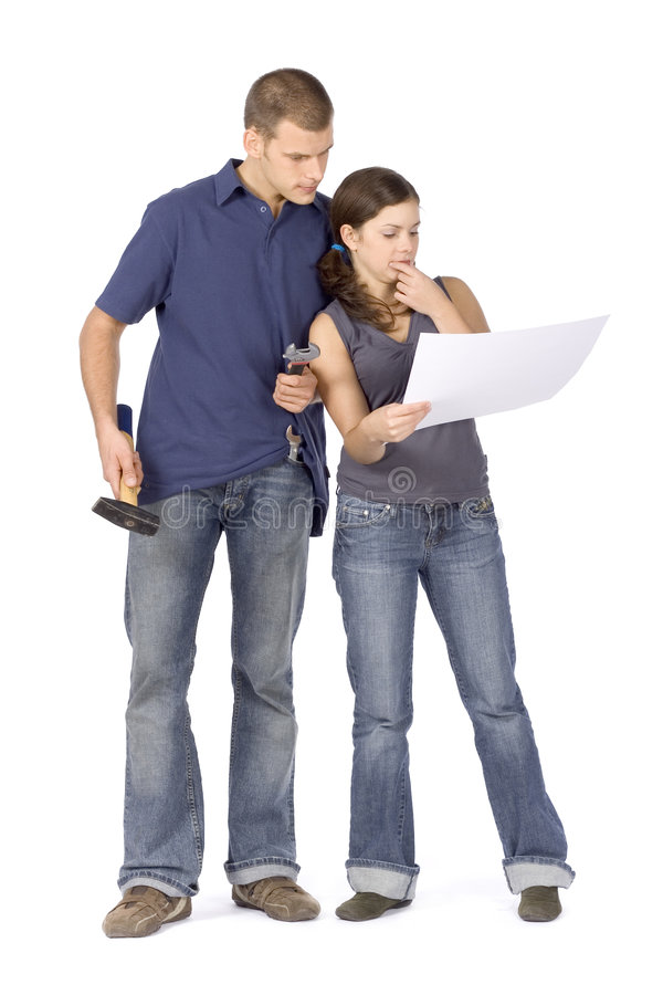 House renovation - couple looking at the plan royalty free stock photography