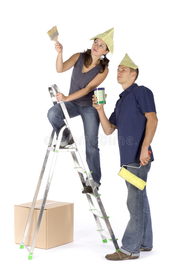 House renovation - couple painting stock photos