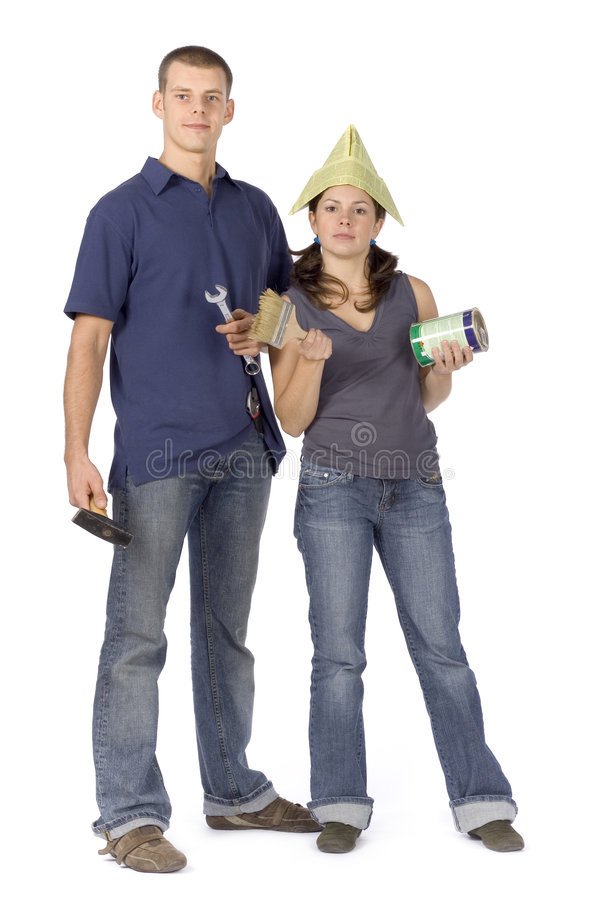 House renovation - couple with tools and paint stock photos