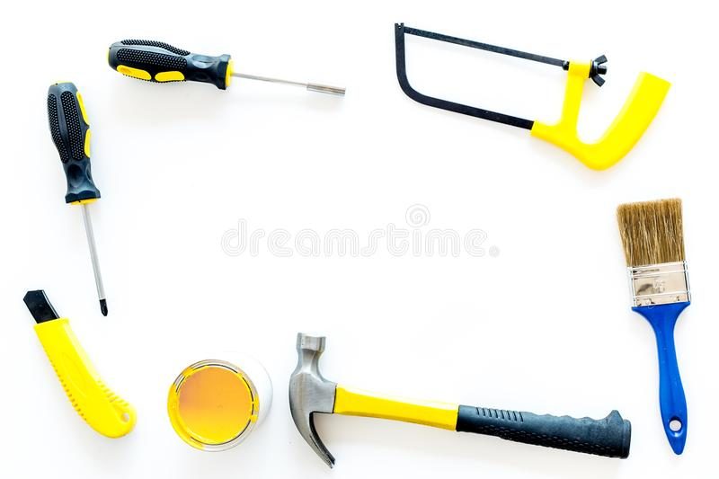 House renovation with implements set for building, painting and repair white table background top view frame mockup. House renovation with implements set for stock images