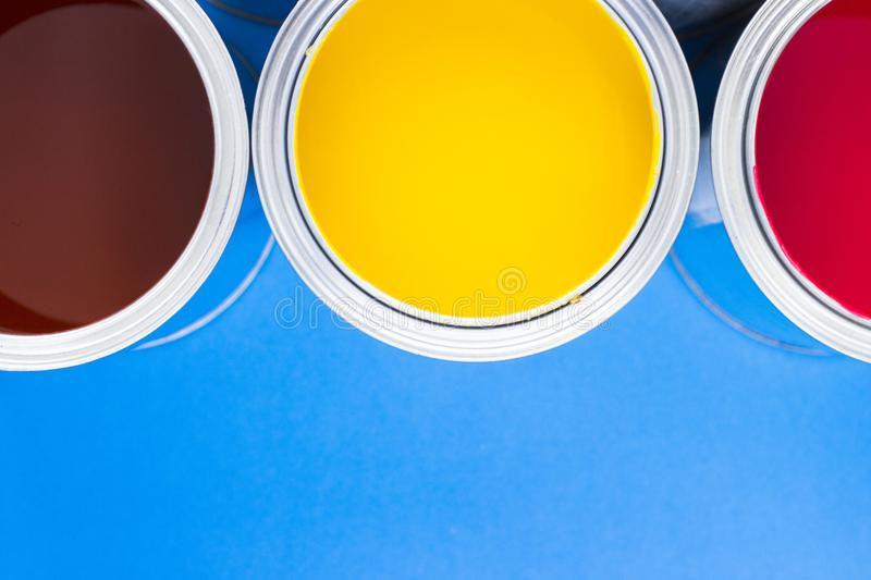 House renovation concept, paint cans and brushes stock photo