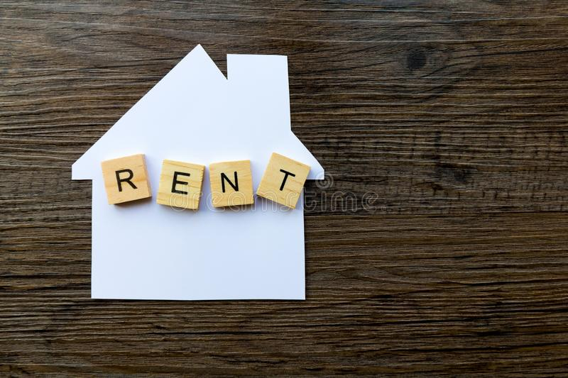 House Rent Concept - copy space provided. House Renting Concept - Paper house with the word `Rent royalty free stock image