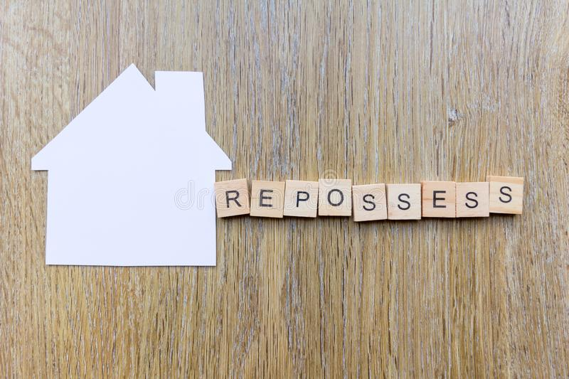 Paper house with the word `repossess` stock photo