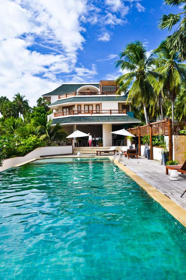House resort with a swimming pool royalty free stock images