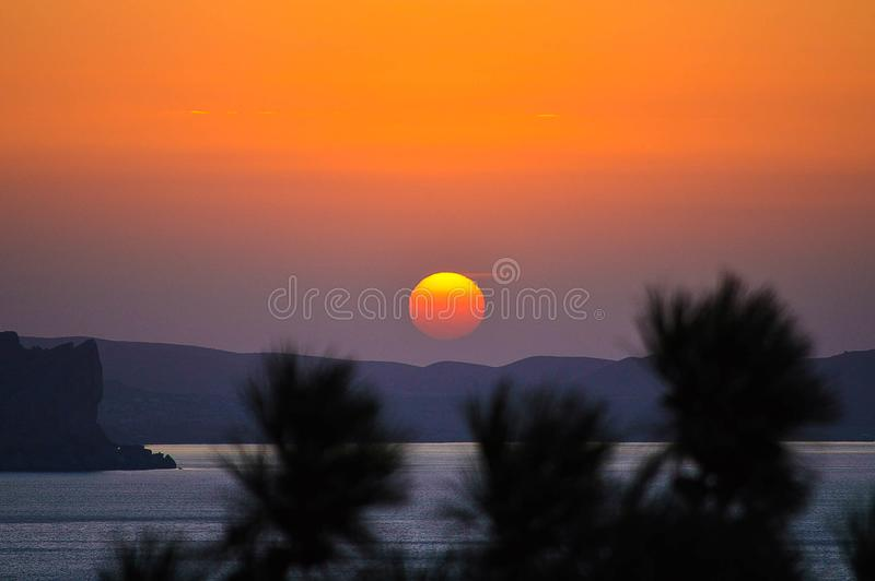 House of the rising sun. Sunrise in Green Bay, the village with the romantic name of the Noviy Svet stock photography
