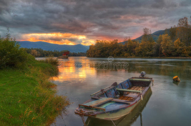 House in river Drina near Bajina Basta, Western Serbia. Amazing autumn picture with lights, beautiful warm colors, house on the rock in river Drina, sunset in stock images