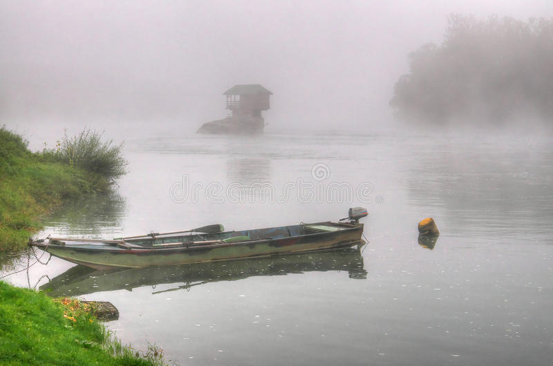 House in river Drina near Bajina Basta, Western Serbia. Amazing autumn picture with morning mist, beautiful soft colors, house on the rock in river Drina and stock photo