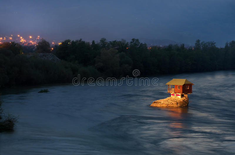 House in river Drina near Bajina Basta, Western Serbia. Amazing night picture with lights, beautiful blue colors, house on the rock in river Drina, soft and royalty free stock photos