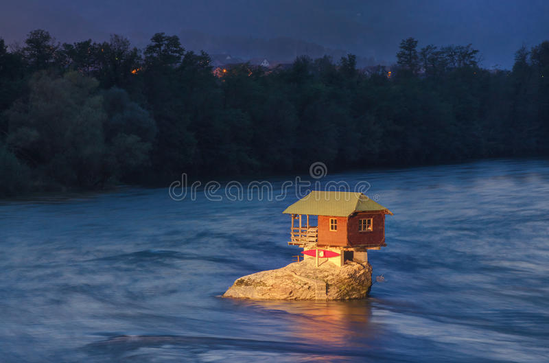 House in river Drina near Bajina Basta, Western Serbia. Amazing night picture with lights, beautiful blue colors, house on the rock in river Drina, soft and stock photos
