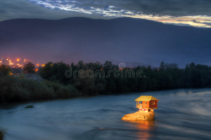 House in river Drina near Bajina Basta, Western Serbia. Amazing night picture with lights, beautiful blue colors, house on the rock in river Drina, soft and stock photography