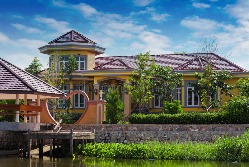 House on the river Nakhon Chai Si. In Thailand stock photos
