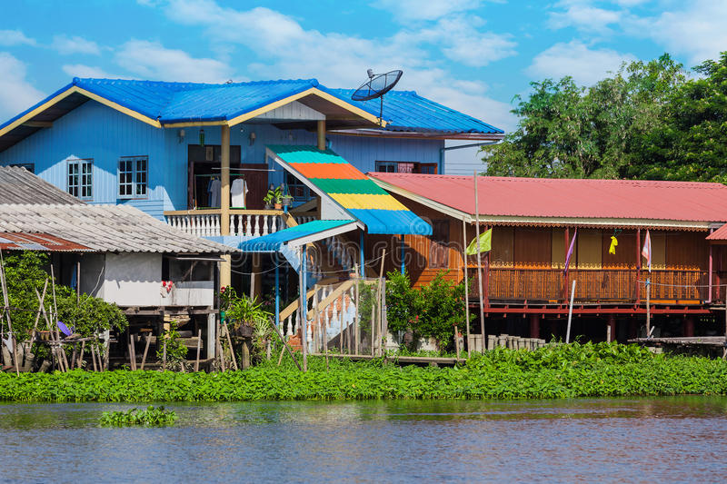 House on the river Nakhon Chai Si. In Thailand royalty free stock image